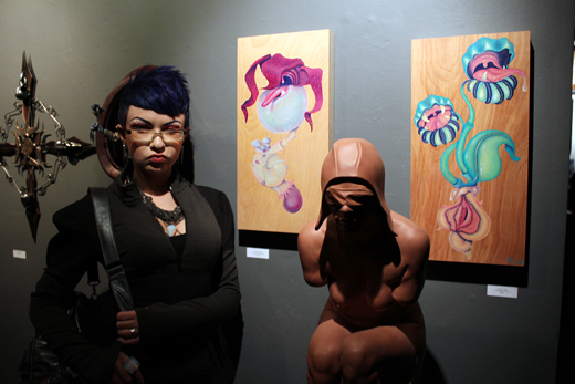 Zoetica Ebb with her paintings at Conjoined 2